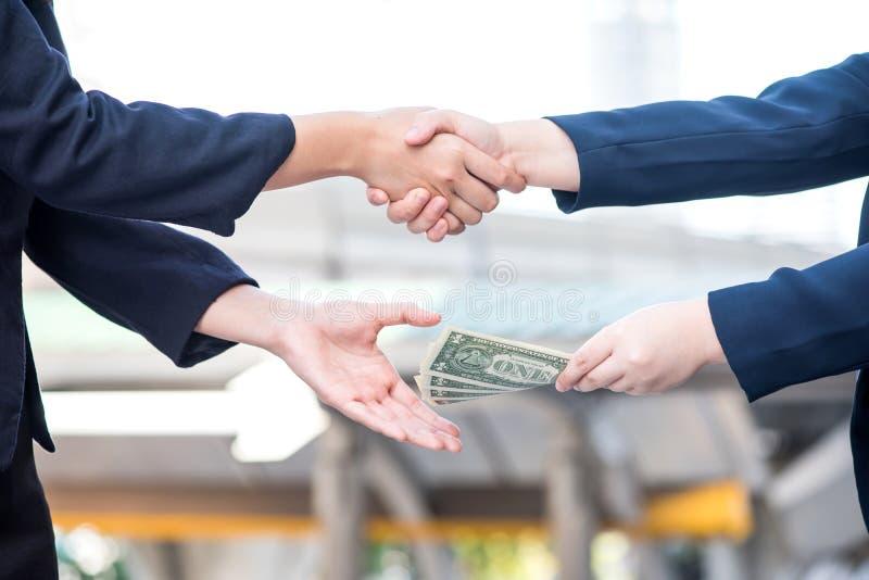 Bedrijfshanddruk met geld royalty-vrije stock foto