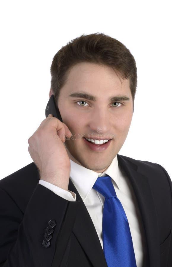 Bedrijfsmens die aan slimme telefoon spreken royalty-vrije stock foto