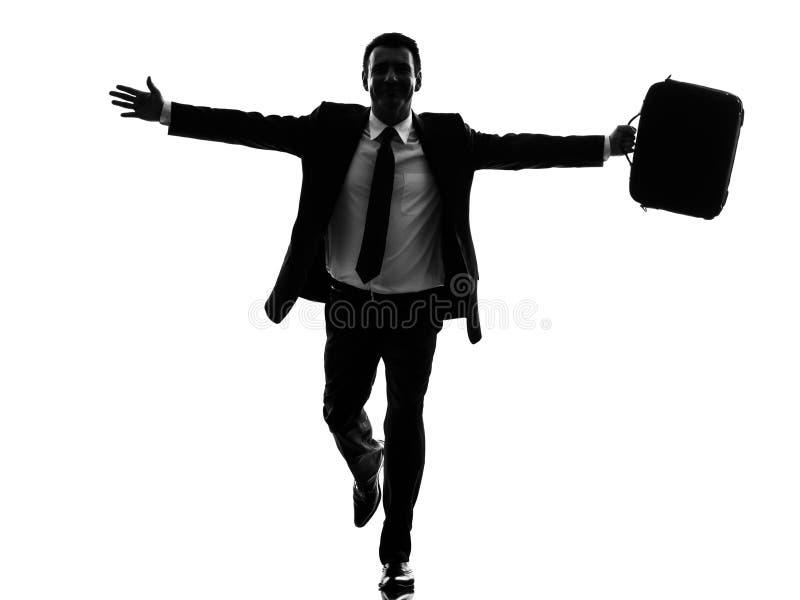 Bedrijfsmens die gelukkig wapens uitgestrekt silhouet in werking stellen royalty-vrije stock foto
