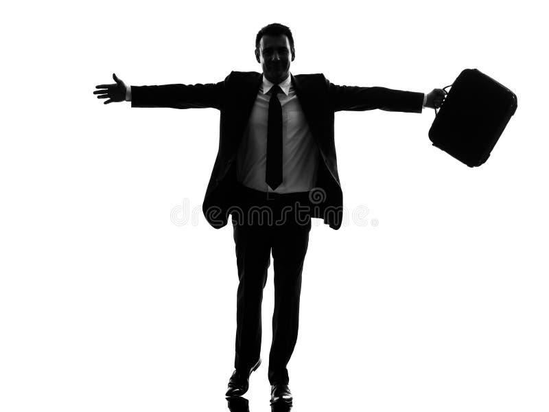 Bedrijfsmens die gelukkig wapens uitgestrekt silhouet in werking stellen royalty-vrije stock foto's