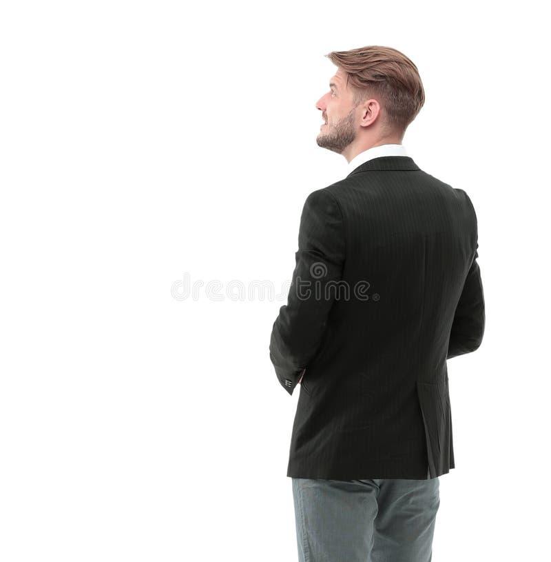 Bedrijfsmens die iets bekijken geïsoleerd op witte achtergrond royalty-vrije stock foto