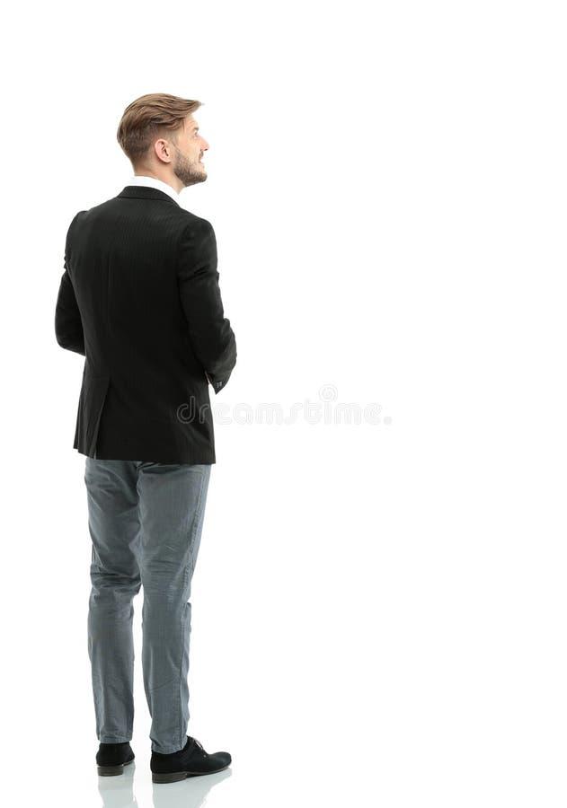 Bedrijfsmens die iets bekijken geïsoleerd op witte achtergrond royalty-vrije stock afbeelding