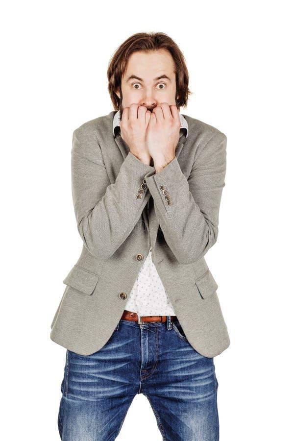 Bedrijfsmens die zijn spijkersvingers bijten die uit freaking menselijke emotio stock fotografie