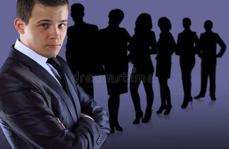Bedrijfsmens en zijn team stock foto