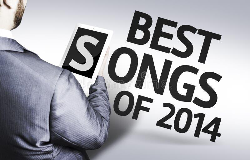 Bedrijfsmens met de tekst Beste Liederen van 2014 in een conceptenbeeld royalty-vrije stock foto