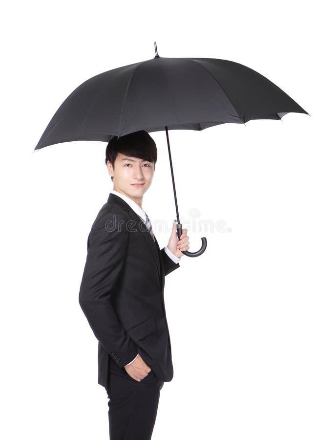 Bedrijfsmens met een paraplu royalty-vrije stock afbeeldingen