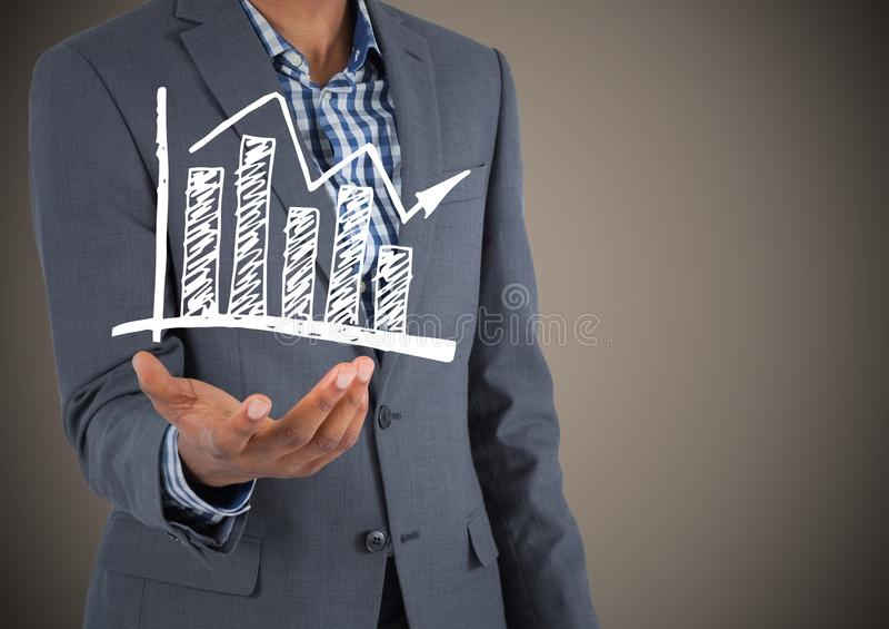 Bedrijfsmensen medio sectie met witte grafiekkrabbel ter beschikking tegen bruine achtergrond stock foto
