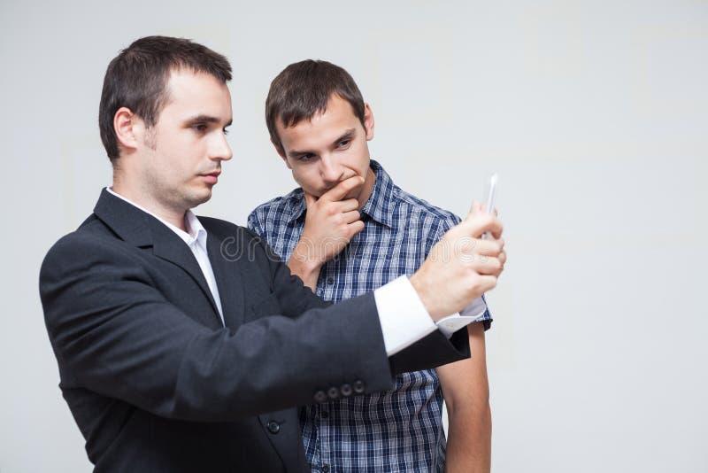 Bedrijfsmensen met digitale tablet stock afbeelding
