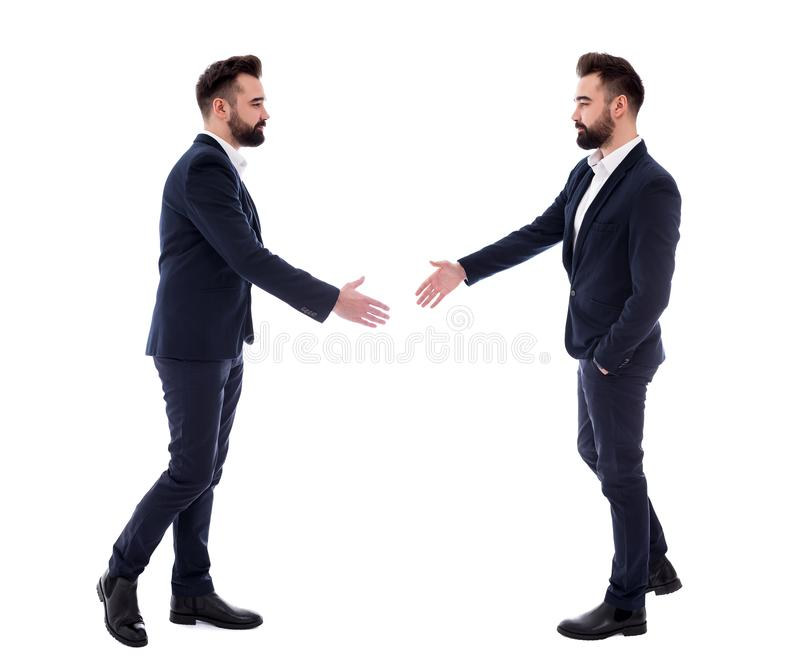 Bedrijfsmensenconcept - twee zelfde die zakenlieden klaar voor handdruk op wit wordt geïsoleerd stock afbeeldingen