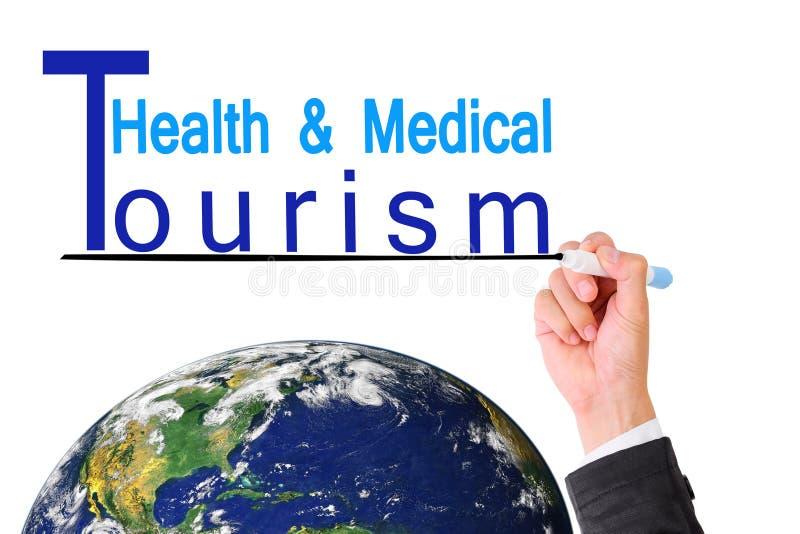 Bedrijfsmensenhand het schrijven Gezondheid Medisch die toerisme over Aarde (Aardekaart door NASA wordt geleverd) royalty-vrije stock afbeelding