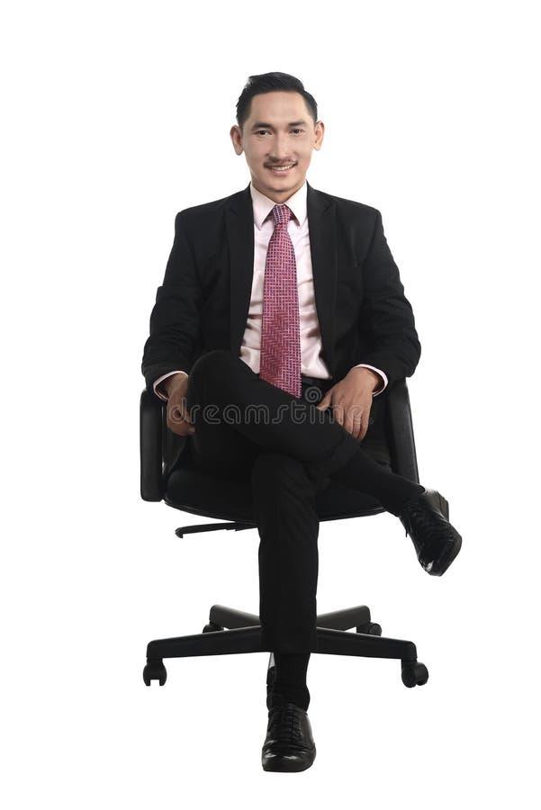 Bedrijfsmensenzitting op de stoel stock foto