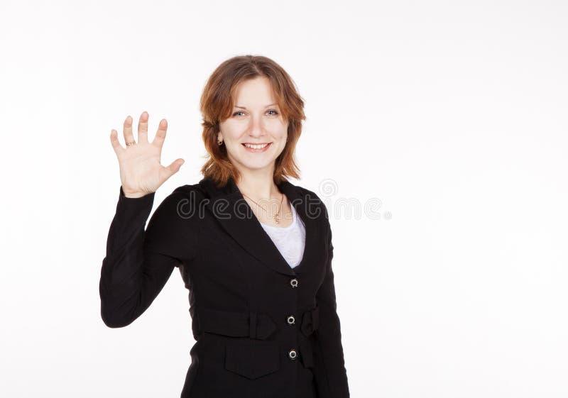 Bedrijfsvrouw die een denkbeeldige plaat houden royalty-vrije stock afbeelding
