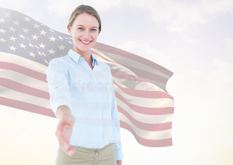Bedrijfsvrouw die haar hand schudden tegen Amerikaanse vlag stock foto's