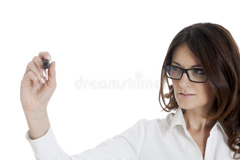 Bedrijfsvrouw die met zwarte markeerstift schrijven stock afbeelding