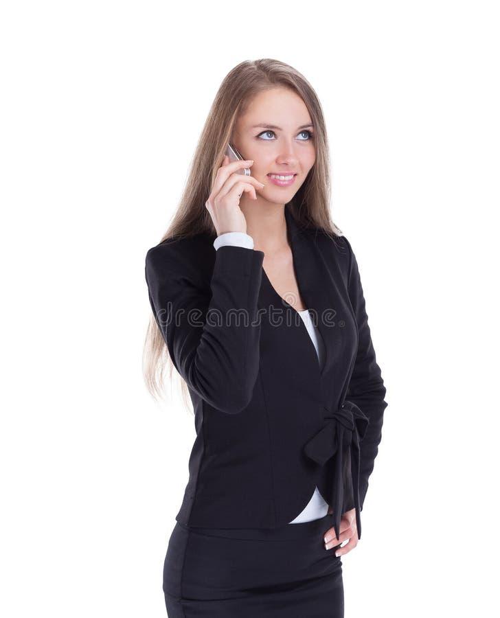 Bedrijfsvrouw die op haar smartphone spreken isoleerde een wit stock afbeeldingen