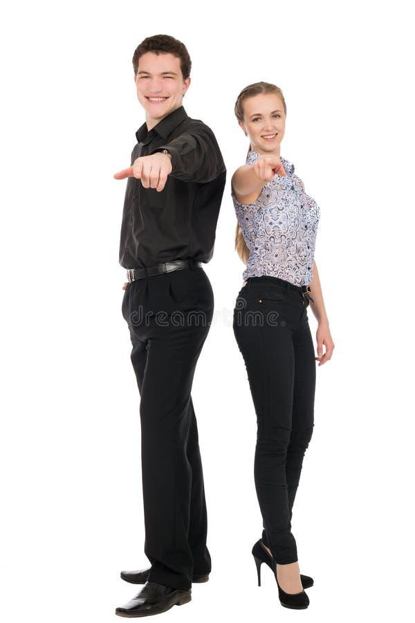 Bedrijfsvrouw en man puntvinger bij u die camera bekijken royalty-vrije stock fotografie