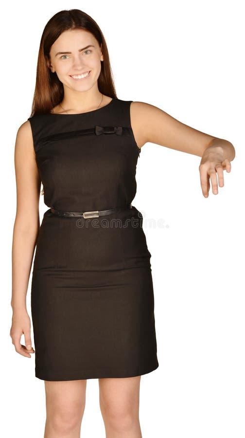 Bedrijfsvrouw met een waarde van duim verminderd te hebben en stock fotografie