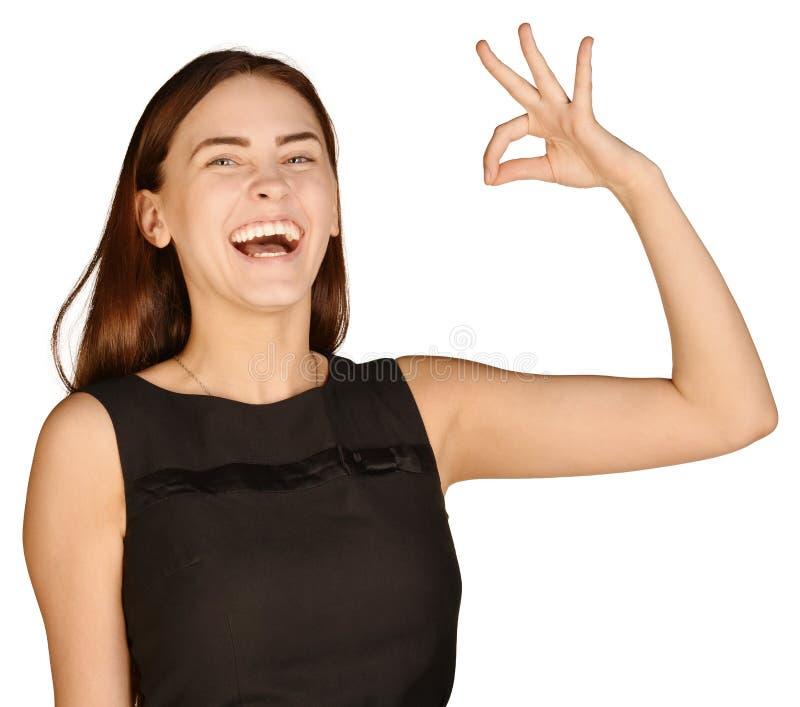 Bedrijfsvrouw met een waarde van duim verminderd te hebben en royalty-vrije stock foto
