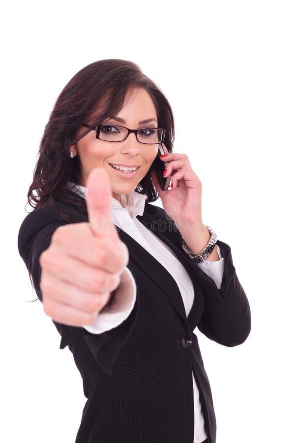 Bedrijfsvrouwenduim omhoog & telefoon royalty-vrije stock fotografie