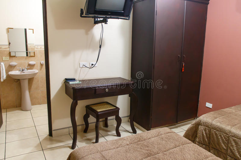 Bedroom and bathroom from a hostel. Bedroom indoors and bathroom from a hostel royalty free stock image