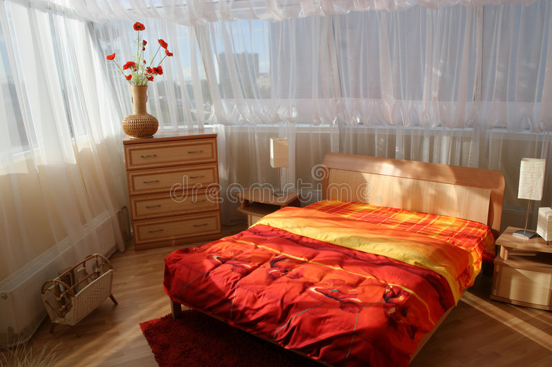 Bedroom with big window. And curtains stock image