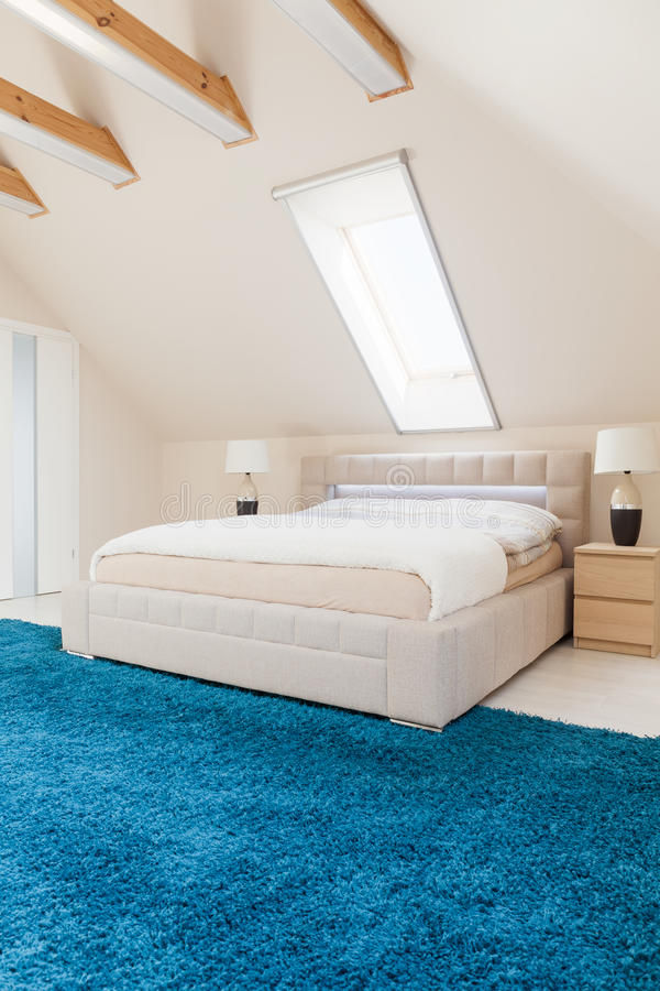 Bedroom with blue carpet stock image. Image of decor - 57884627