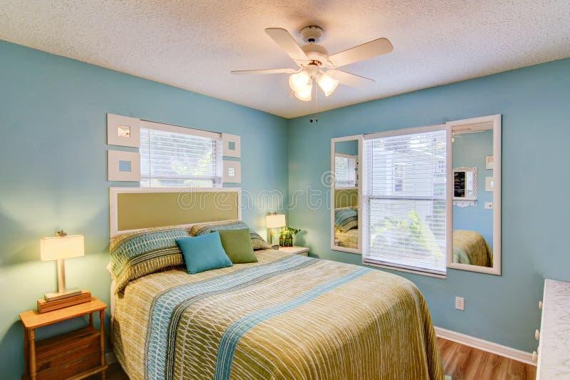 Bedroom. Blue Bedroom with queen size bed stock image