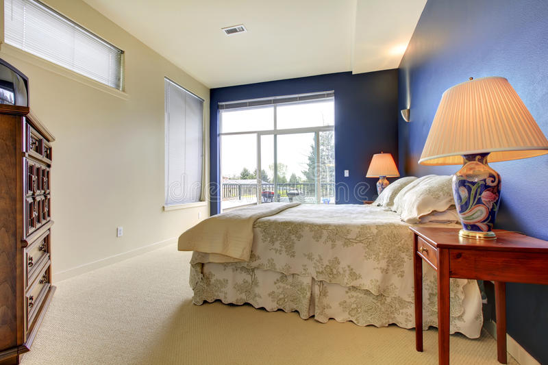 Bedroom With Blue Wall And Asian Lamps. Royalty Free Stock Photography