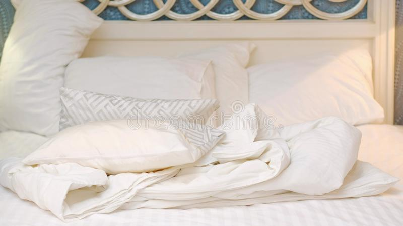 Bedroom comfort bedding sheets woman making bed. Bedclothes. comfortable bedding sheets. bed linen. morning bedroom mess royalty free stock image