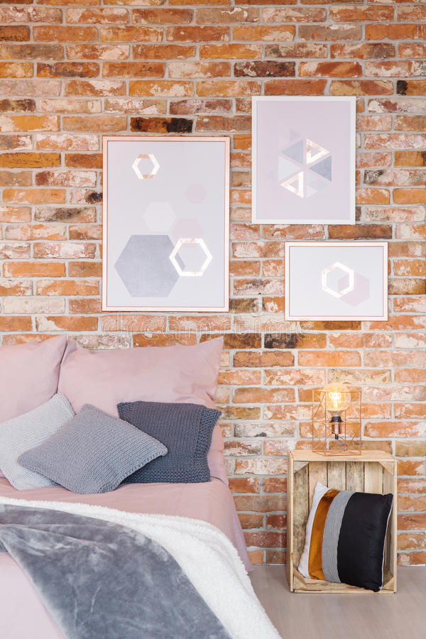 Bedroom with crate bedside table. Trendy bedroom with crate bedside table and wall decoration stock photos
