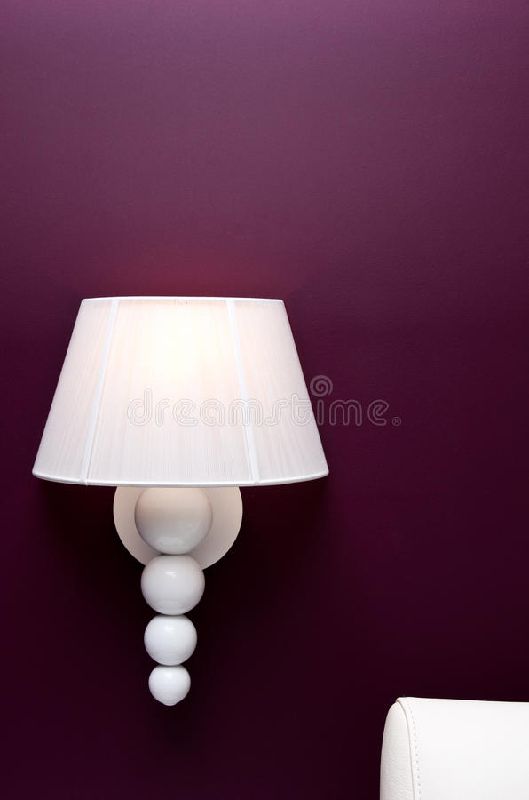 Lamp on purple wall royalty free stock image