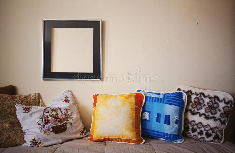 Bedroom Decoration Pillows and Picture Frame stock photo