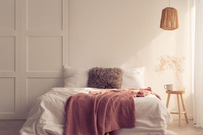 Bedroom design idea with king size bed with pink blanket, real photo stock photo