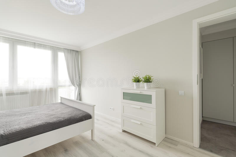Bedroom designed in minimalist colors stock image