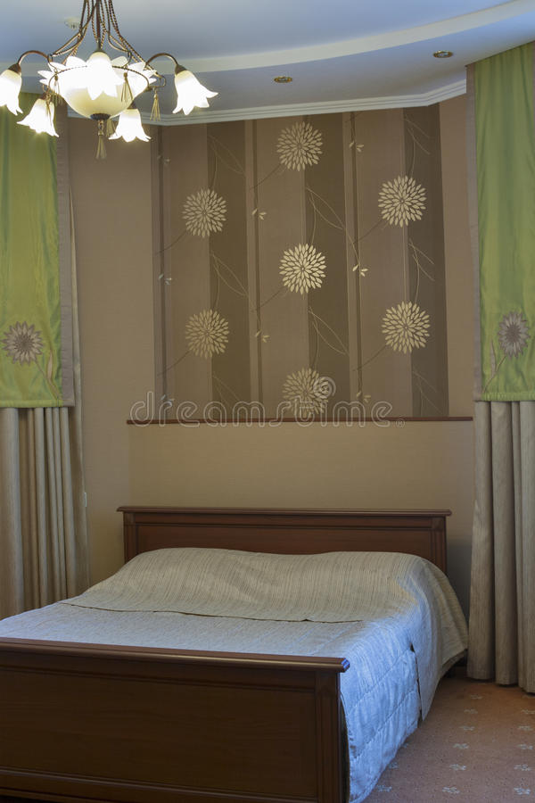 Bedroom with double bed stock images