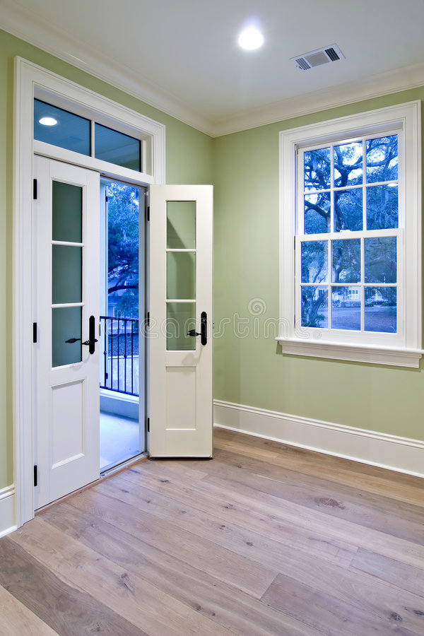 Bedroom with double doors stock photo. Image of building - 5181372