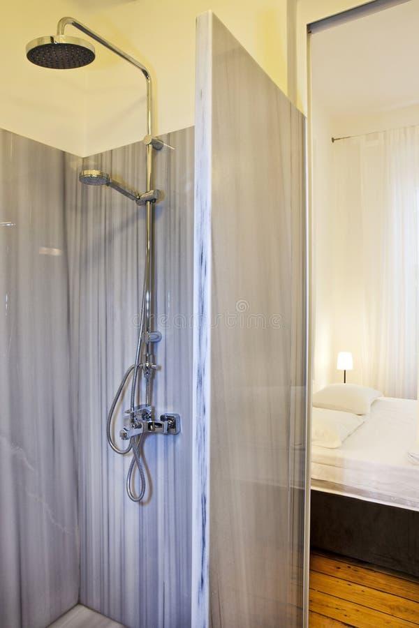 Bedroom with en suite bathroom. Luxury penthouse bedroom with en suite bathroom royalty free stock photography