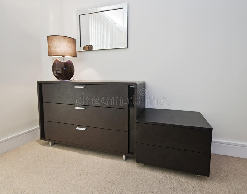 Bedroom furniture. Hard wood bedroom furniture with reading lamp and mirror royalty free stock photo