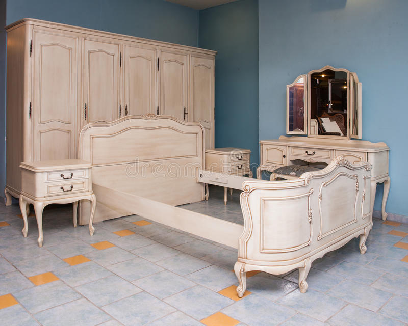 Bedroom furniture. In antique furniture shop royalty free stock photography