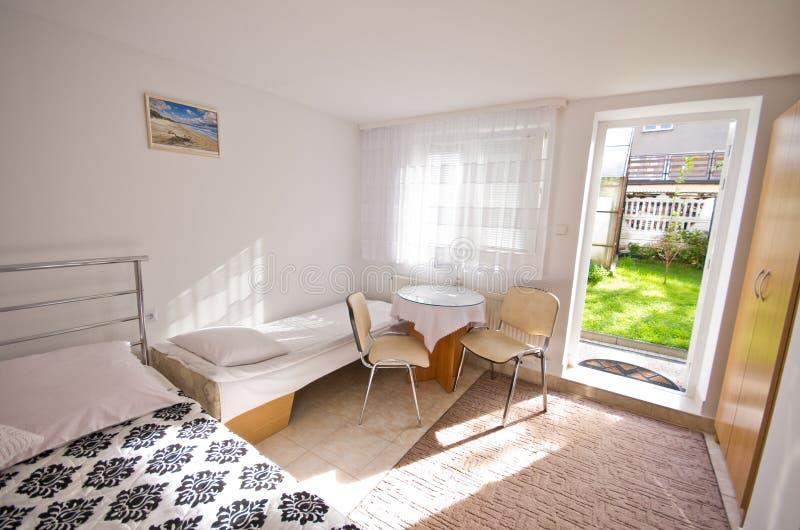 Bedroom with garden door stock photography