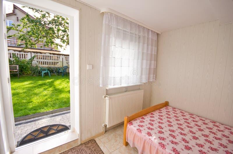 Bedroom with garden door stock images