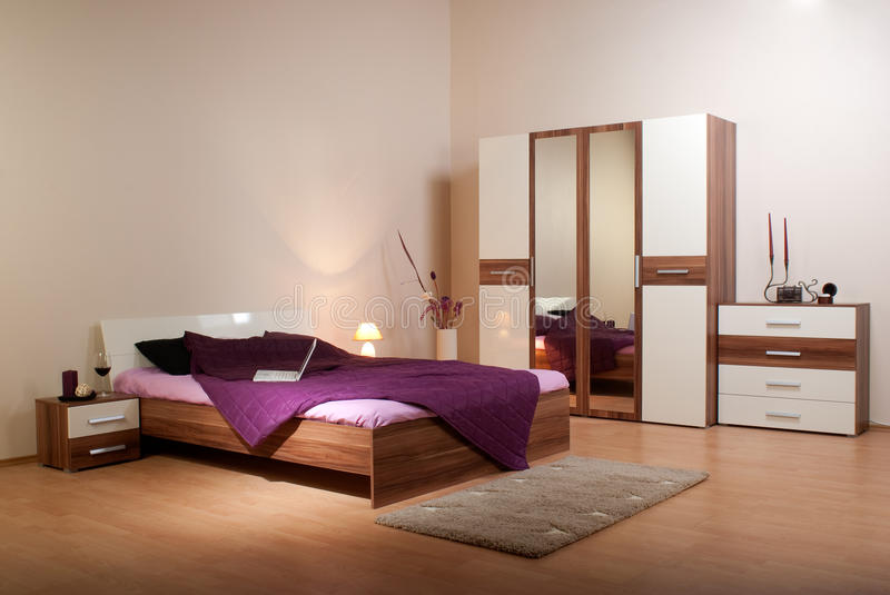 Bedroom interior. Showcase including bed, wardrobe, bedside table commodes, linen-press