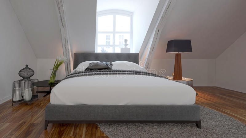 Bedroom interior with bed under a roof slope stock images