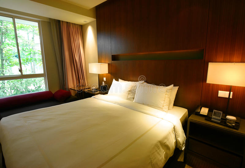 Bedroom interior with garden view royalty free stock photos