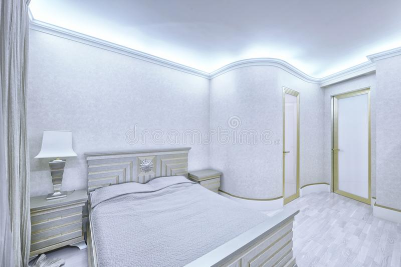 Bedroom interior in white color modern house. Designer modern renovation in a luxury house. Stylish bedroom interior with double bed stock image