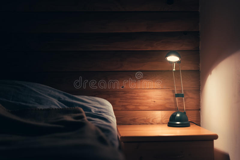 Bedroom lamp on a night table stock images