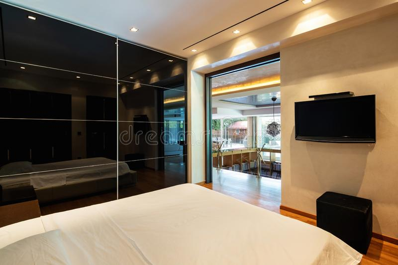 Bedroom in luxury apartment royalty free stock images