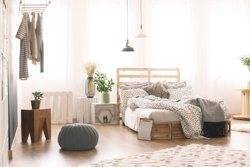Bedroom with modern furniture. Cozy bedroom with modern wooden furniture royalty free stock image