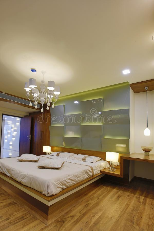 Bedroom in modern home, Calicut, India. Bedroom interior in home designed by Amar Architecture and Designs PVT, Ltd in Calicut, India stock photo