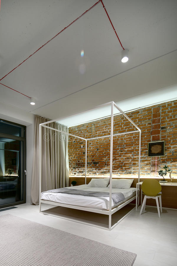 Download Bedroom In A Modern Loft Style  Brick Wall Without Plaster  Bed  Stock Image. Bedroom In A Modern Loft Style  Brick Wall Without Plaster  Bed